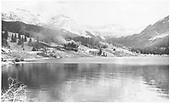 View of Trout Lake with water tank on right side of picture.  Freight is approaching tank.<br /> RGS  Trout Lake, CO