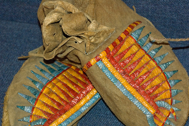 Decorrative porcupine quillwork was embroidered onto various items such as these buffalo hide men's moccasins on display at the Three Affiliated Tribes Museum on the Fort Berthold Indian Reservation, ND