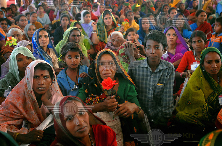 A crowd of Dalit women and their children come together for the 2006 Vanangana conference in Chitrakoot. Vanangana, a women's group dedicated to human rights issues, receives strong support from the Dalit community. The members of the segregated low-ranking Dalit caste perform the most menial jobs in Hindu society and are considered to be literally 'untouchable'.