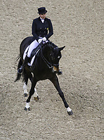 OMAHA, NEBRASKA - MAR 30: Inessa Merkulova rides Mister X during the FEI World Cup Dressage Final I at the CenturyLink Center on March 30, 2017 in Omaha, Nebraska. (Photo by Taylor Pence/Eclipse Sportswire/Getty Images)