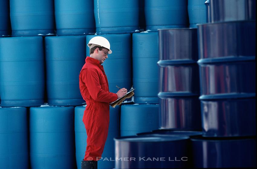 Technician checking shipment of hazardous material
