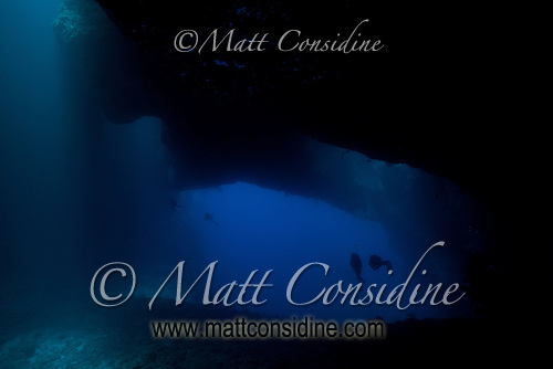 Looking out from the back of Blue Holes into the deep blue open sea. The shafts of light are from the holes in the top of the cavern that give Blue Holes its name, Palau Micronesia. (Photo by Matt Considine - Images of Asia Collection) (Matt Considine)