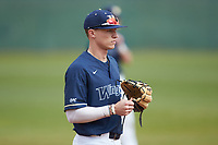 Wingate Bulldogs third baseman Clayton Nestor (23) on defense against the Concord Mountain Lions at Ron Christopher Stadium on February 1, 2020 in Wingate, North Carolina. The Bulldogs defeated the Mountain Lions 8-0 in game one of a doubleheader. (Brian Westerholt/Four Seam Images)