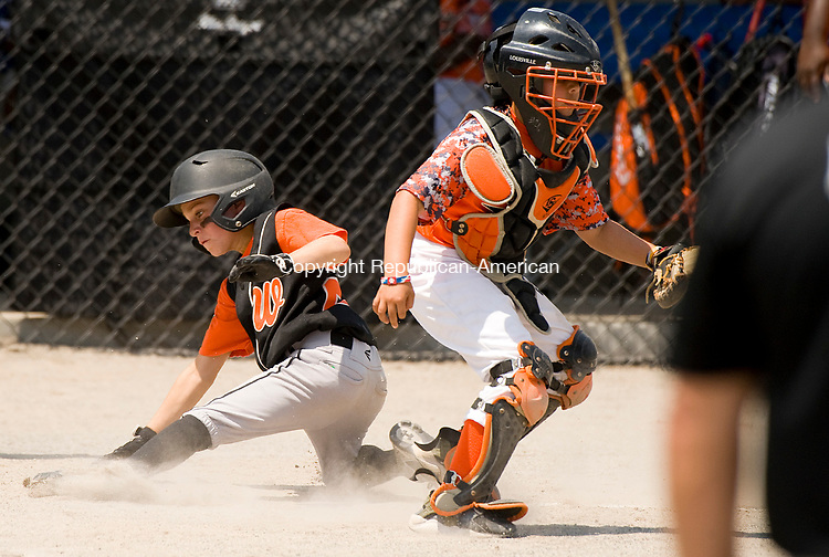 WATERBURY, CT-0712117JS09--Water-Oak's T.J. Angiolini (24) comes on to score during their consolation bracket game against the Bonnie's of Brooklyn in the Roberto Clemente Tournament Thursday at the Waterbury PAL field. <br /> Jim Shannon Republican-American