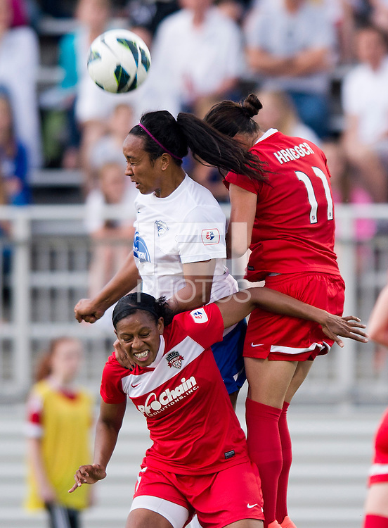 Mariah Noguiera (20) of the Boston Breakers goes up for a header with Ali Krieger (11) and Robyn Gayle (15)  of the Washington Spirit during the game at the Maryland SoccerPlex in Boyds, MD.  Washington tied Boston, 1-1.