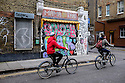 London, UK. 04.04.2015. Cyclists on a cycle tour, pass Mama Thai, East London. Photograph © Jane Hobson.