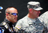 Jun. 16, 2012; Bristol, TN, USA: NHRA top fuel dragster driver Tony Schumacher with an Army soldier during qualifying for the Thunder Valley Nationals at Bristol Dragway. Mandatory Credit: Mark J. Rebilas-