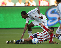 Chivas USA defender Jonathan Bornstein (13) slidetackles Real Salt Lake forward Atiba Harris (7). CD Chivas USA beat Real Salt Lake 1-0 in a MLS game at the Home Depot Center in Carson, California, Sunday, August 26, 2007.