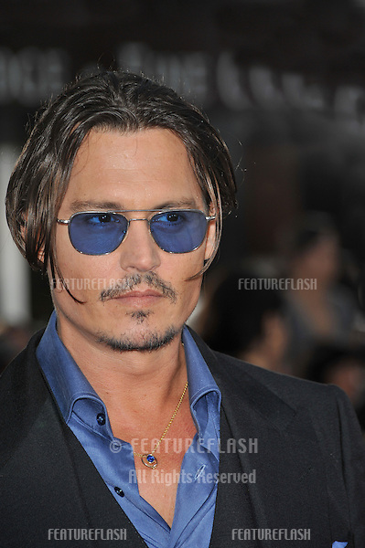 "Johnny Depp at the Los Angeles premiere of his new movie ""Public Enemies"" at Mann Village Theatre, Westwood..June 23, 2009  Los Angeles, CA.Picture: Paul Smith / Featureflash"