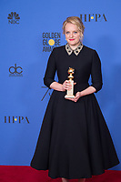 After winning the category of BEST PERFORMANCE BY AN ACTRESS IN A TELEVISION SERIES &ndash; DRAMA for her role in &quot;The Handmaid's Tale,&quot; actress Elisabeth Moss poses backstage in the press room with her Golden Globe Award at the 75th Annual Golden Globe Awards at the Beverly Hilton in Beverly Hills, CA on Sunday, January 7, 2018.<br /> *Editorial Use Only*<br /> CAP/PLF/HFPA<br /> &copy;HFPA/PLF/Capital Pictures