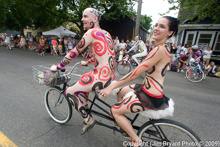 A pair of geometric painted bikers peddle down the street during the 201st Annual Fremont Summer Solstice Parade in Seattle on June 20, 20089  The parade was held Saturday, bringing out painted and naked bicyclists, bands, belly dancers and floats. (Jim Bryant Photo © 2009)