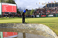 Scott Hend (AUS) putts from the waters edge on the 18th green on the 3rd playoff hole during Sunday's Final Round of the 2017 Omega European Masters held at Golf Club Crans-Sur-Sierre, Crans Montana, Switzerland. 10th September 2017.<br /> Picture: Eoin Clarke | Golffile<br /> <br /> <br /> All photos usage must carry mandatory copyright credit (&copy; Golffile | Eoin Clarke)