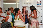 Lola Ogunnaike (far right) speaking with guests during the African Health Now - Fashion Fete event, at the Tracy Reese store on 641 Hudson Street, June 20, 2013.