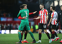 David Raya of Brentford hugs Emiliano Marcondes at the final whistle to celebrate their 3-2 victory during Brentford vs Middlesbrough, Sky Bet EFL Championship Football at Griffin Park on 8th February 2020