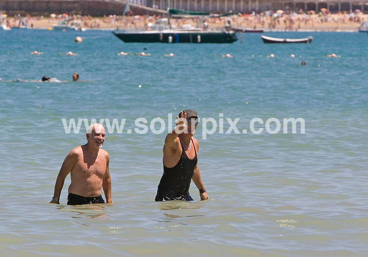 **ALL ROUND PICTURES FROM SOLARPIX.COM**.**SYNDICATION RIGHTS FOR UK, USA & CANADA**.Bruce Springsteen spotted out and about in San Sebastian, Northern Spain. He is staying in a local 5 star hotel and in the morning he took a spar and went to the gym before visiting the beach with a friend. He laughed and joked for the cameras as he took a dip in the sea..JOB REF:  9602     SKX     DATE:  25.07.09.**MUST CREDIT SOLARPIX.COM OR DOUBLE FEE WILL BE CHARGED**.**ONLINE USAGE  - NOTIFICATION OF USAGE TO PHOTO @ SOLARPIX.COM**.**CALL SOLARPIX : +34 952 811 768 or LOW RATE FROM UK 0844 617 7637**.