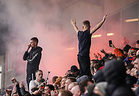 A Fleetwood Town fans watch their team in action as a smoke bomb is let off<br /> Photographer Lee Parker/CameraSport<br /> <br /> The EFL Sky Bet League One - Fleetwood Town v Blackpool - Saturday 7th March 2020 - Highbury Stadium - Fleetwood<br /> <br /> World Copyright © 2020 CameraSport. All rights reserved. 43 Linden Ave. Countesthorpe. Leicester. England. LE8 5PG - Tel: +44 (0) 116 277 4147 - admin@camerasport.com - www.camerasport.com