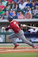 Andrew Knapp (15) of the Lehigh Valley Iron Pigs follows through on his swing against the Charlotte Knights at BB&T BallPark on June 3, 2016 in Charlotte, North Carolina.  The Iron Pigs defeated the Knights 6-4.  (Brian Westerholt/Four Seam Images)