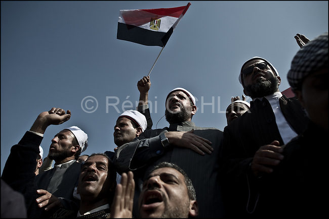 "© Remi OCHLIK/IP3 - Cairo Feb. 01 -- Tahrir square - Men from muslim brotherhood organization protest during the Egypt's ""million man march"".. Whether they achieved that targeted head count is unclear, but their message was unequivocal.""Mubarak get out!"" protesters chanted. Tuesday's rally in downtown Cairo was the largest anti-government demonstration in modern Egyptian history, drawing the full spectrum of Egyptian society. Wave after wave of men, women and children poured into the central square from morning until well after the government's 3pm curfew...It was the eighth consecutive day of protests calling for Egyptian President Hosni Mubarak to step down. Earlier this week the 83-year-old dictator, who has ruled Egypt for 30 years, appointed a vice-president and changed his cabinet to appease the public's growing anger. Protesters say he has missed the point entirely."