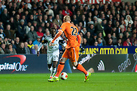 Thursday 28 November  2013  Pictured:Nathan Dyer takes the ball around Jeremy Mathieu of Valencia<br /> Re:UEFA Europa League, Swansea City FC vs Valencia CF  at the Liberty Staduim Swansea