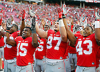 Ohio State Buckeyes running back Ezekiel Elliott (15), Ohio State Buckeyes defensive lineman Joey Bosa (97) and Ohio State Buckeyes linebacker Darron Lee (43) sing Carmen Ohio after beating Northern Illinois Huskies 20-13 during their game at Ohio Stadium on September 19, 2015.  (Dispatch photo by Kyle Robertson)