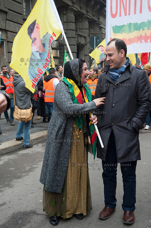Milano, corteo per chiedere la liberazione del leader del Pkk, Abdullah Ocalan, in carcere dal 1999. Una donna curda parla con il deputato Faysal Sariyildiz.<br /> Milan, march to demand the release of PKK leader Abdullah Ocalan, in prison since 1999. A Kurdish woman speaks with Congressman Faysal Sariyildiz.<br /> Feb 11,2017