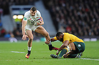 Jonny May of England escapes the tackle of Sekope Kepu of Australia during the Old Mutual Wealth Series match between England and Australia at Twickenham Stadium on Saturday 3rd December 2016 (Photo by Rob Munro)