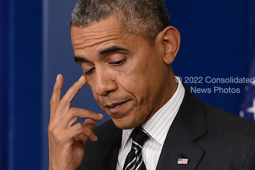 United States President Barack Obama gestures while delivering a statement on the budget, a possible US government shutdown and foreign policy, at the White House in Washington DC, USA, 27 September 2013.<br /> Credit: Michael Reynolds / Pool via CNP