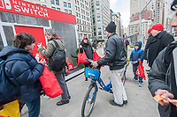 Gamers cluster around a Nintendo Switch event in Flatiron Plaza in New York grabbing freebies from workers on the launch day of the new Nintendo Switch console on Friday, March 3, 2017. (© Richard B. Levine)