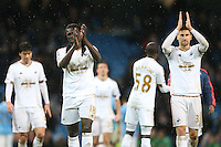 Ki Sung-Yueng, Bafetibis Gomis and Frederico Fernandez look dejected at the end of the Barclays Premier League Match between Manchester City and Swansea City played at the Etihad Stadium, Manchester on 12th December 2015