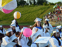 BENSALEM, PA - JUNE 18: Victoria Rose Hall (C) hits a beach ball in the air during Bensalem High School's 90th Annual Commencement ceremony June 18, 2014 at Bensalem Memorial Stadium in Bensalem, Pennsylvania. About 500 students graduated. (Photo by William Thomas Cain/Cain Images)