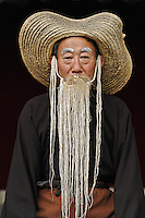 Old man in dance costume, Tang Mo Village, China