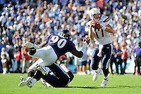 Sep. 20, 2009; San Diego, CA, USA; San Diego Chargers quarterback (17) Phillip Rivers evades Baltimore Ravens defensive end (90) Trevor Pryce at Qualcomm Stadium in San Diego. Baltimore defeated San Diego 31-26. Mandatory Credit: Mark J. Rebilas-