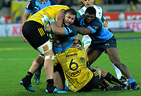 Bulls captain Handre Pollard  is wrapped up during the Super Rugby quarterfinal between the Hurricanes and Bulls at Westpac Stadium in Wellington, New Zealand on Saturday, 22 June 2019. Photo: Dave Lintott / lintottphoto.co.nz