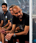 Manchester City Manager Pep Guardiola (r) during their 2016 International Champions Cup China match against Borussia Dortmund at the Shenzhen Stadium on 28 July 2016 in Shenzhen, China. Photo by Marcio Machado / Power Sport Images