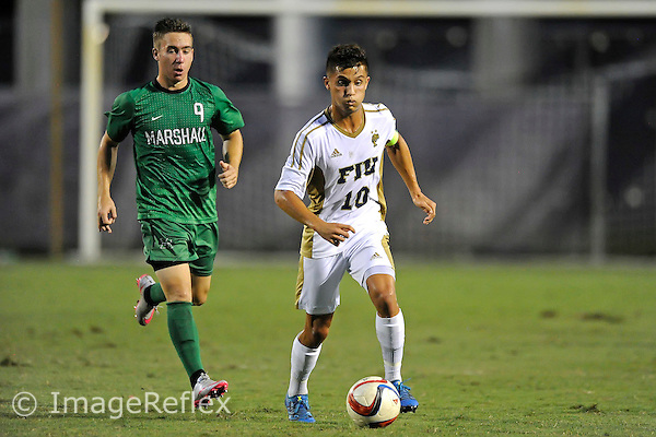 26 September 2015:  FIU midfielder Daniel Gonzalez (10) advances the ball in the first half as the FIU Golden Panthers defeated the Marshall University Thundering Herd, 5-1, at University Park Stadium in Miami, Florida.