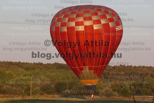 Balloon lands on afield during the Velence Lake International Hot Air Balloon Festival in Agard, Slovakia on September 10, 2011. ATTILA VOLGYI