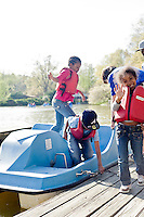 (l to R) Brianca Williams, Ahmari  Bradley, and Ahbria Bradley on the paddle boats at Pullen Park.