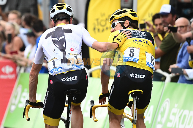 Overall winner Yellow Jersey Geraint Thomas (WAL) and 3rd place Chris Froome Team Sky congratulate one another at the end of Stage 21 of the 2018 Tour de France running 116km from Houilles to Paris Champs-Elysees, France. 29th July 2018. <br /> Picture: ASO/Alex Broadway | Cyclefile<br /> All photos usage must carry mandatory copyright credit (&copy; Cyclefile | ASO/Alex Broadway)
