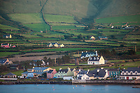 County Kerry, Ireland:<br /> Evening light on the colorful port village of Portmagee, on the tip of the Iveragh peninsula