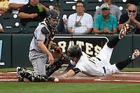 Jupiter Hammerheads catcher Chadd Krist (6) looks for the ball as Wyatt Mathisen (15) scores a run during a game against the Bradenton Marauders on April 17, 2015 at McKechnie Field in Bradenton, Florida.  Bradenton defeated Jupiter 11-6.  (Mike Janes/Four Seam Images)