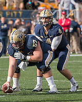 Pitt center Artie Rowell and quarterback Nate Peterman. The Miami Hurricanes football team defeated the Pitt Panthers 29-24 on  Friday, November 27, 2015 at Heinz Field, Pittsburgh, Pennsylvania.