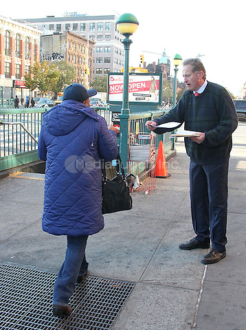 NEW YORK, NY - NOVEMBER 7: A day before the the general election, Scott Fenstermaker, candidate for U.S. Congress for the 13th Congressional District, hands out flyers to passersby in front of the 125th subway station in Harlem in New York, New York on November 7, 2016.  Photo Credit: Rainmaker Photo/MediaPunch