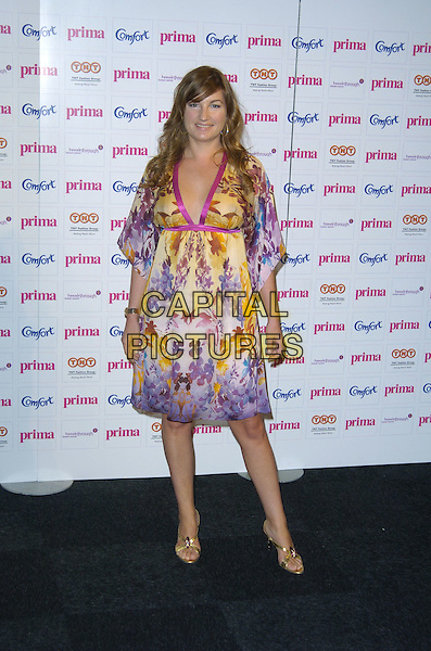 KARREN BRADY.Prima High Street Fashion Awards, Evolution, Battersea Park, London, England..September 13th, 2007..full length purple yellow dress pattern print gold shoes.CAP/CAN.©Can Nguyen/Capital Pictures
