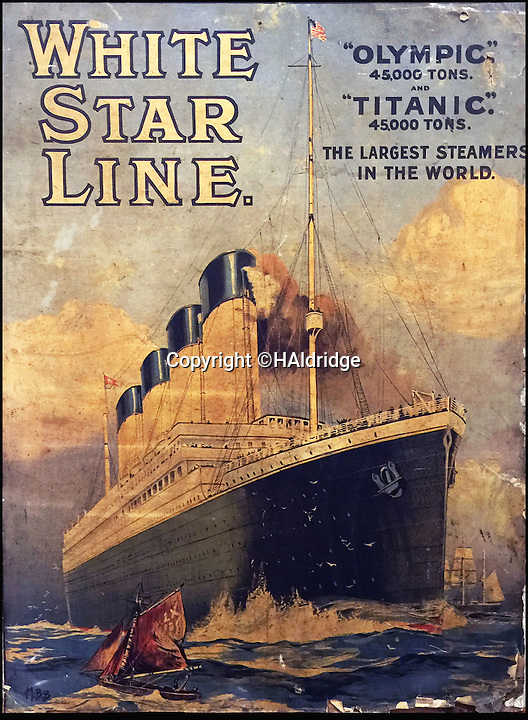 BNPS.co.uk (01202 558833)<br /> Pic: HAldridge/BNPS<br /> <br /> Rare find revealed behind a wall.<br /> <br /> An incredibly rare travel poster advertising trips on the Titanic has been discovered on the back of painting that has been hidden behind a false wall for 100 years.<br /> <br /> A couple renovating their Victorian home in Wales stumbled upon the lithographic poster after knocking through a stud wall in their living room.<br /> <br /> It is being sold for &pound;3,000 along with two other vintage promotional posters for the ill-fated liner at auction in Wiltshire.