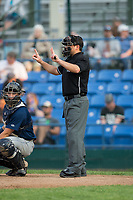 Home plate umpire Phil Bando indicates the count during the Pioneer League game between the Helena Brewers and the Great Falls Voyagers at Centene Stadium on August 19, 2017 in Helena, Montana.  The Voyagers defeated the Brewers 8-7.  (Brian Westerholt/Four Seam Images)