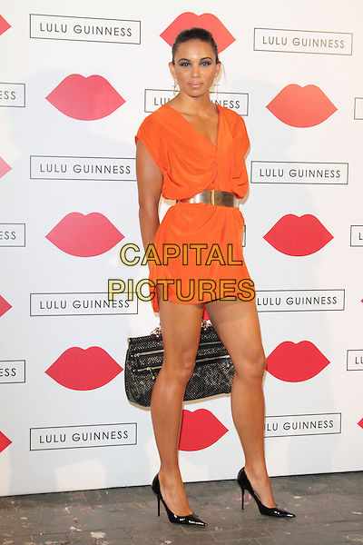 Louise Hazel<br /> Lulu Guinness Paint Project Party at The Old Sorting Office, New Oxford Street, London, UK, July 11th 2013.<br /> full length dress orange v-neck low cut smiling gold belt waist shoes black bag <br /> CAP/ROS<br /> &copy;Steve Ross/Capital Pictures