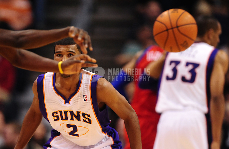 Dec. 28, 2011; Phoenix, AZ, USA; Phoenix Suns guard Ronnie Price keeps his eyes on an opponent during game against the Philadelphia 76ers at the US Airways Center. The 76ers defeated the Suns 103-83. Mandatory Credit: Mark J. Rebilas-USA TODAY Sports