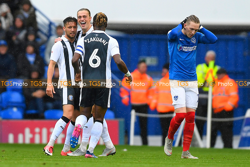 Tom Eaves of Gillingham celebrates scoring the first goal as Ronan Curtis of Portsmouth right looks miserable during Portsmouth vs Gillingham, Sky Bet EFL League 1 Football at Fratton Park on 6th October 2018