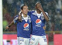 BOGOTÁ -COLOMBIA, 23-11-2013. Erick Moreno (D) y Dayro Moreno (I) de Millonarios celebran un gol en contra del Deportivo Pasto durante partido por la fecha 3 de los cuadrangulares finales de la Liga Postobón  II 2013 jugado en el estadio Nemesio Camacho el Campín de la ciudad de Bogotá./ Erick Moreno (R) and Dayro Moreno (L) of Millonarios celebrate a goal  against Deportivo Pasto during match for the 3rd date of final quadrangulars of the Postobon  League II 2013 played at Nemesio Camacho El Campin stadium in Bogotá city. Photo: VizzorImage/Gabriel Aponte/STR