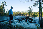 Dirk van Wijk, owner and operator of OWL Rafting on the Ottawa River examines the river late in the evening. Although the proposed Energy East pipeline does not cross the Ottawa River it crosses many major and minor tributaries that feed into the system. A leak in any of those watersheds could impact the Ottawa River and have consequences for the million dollar industy that is tourism on the Ottawa. (Credit: Robert van Waarden - http://alongthepipeline.com)